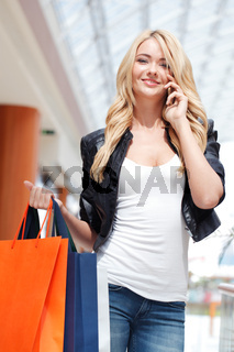 Shopping girl talking on the phone