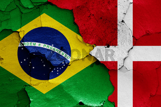 flags of Brazil and Denmark painted on cracked wall