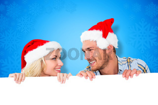 Composite image of young festive couple