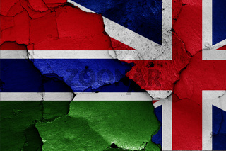 flags of Gambia and UK painted on cracked wall