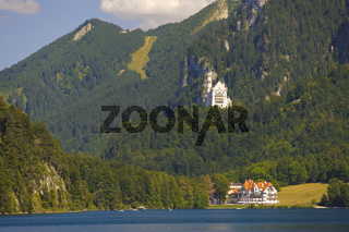 panorama rural landscape with lake Alpsee and castle Neuschwanstein in Bavaria