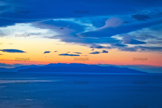 Kvarner bay and island of Krk on open sea at golden dawn view