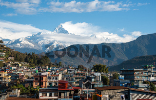 The cityscape of Pokhara with the Annapurna mountain range Nepal, Asia