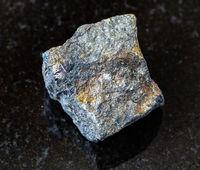 rough Bornite with Chalcopyrite rock on black