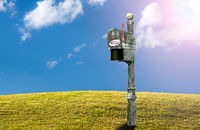 USPS metal mailboxes for rural homes with I voted sticker for vote by mail