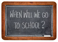 When will we go to school?  Chalk on blackboard.