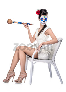 Day of the dead girl with sugar skull make-up isolated on white