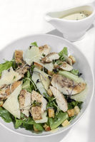 organic chicken caesar salad with parmesan cheese and croutons