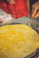 Making savoury pancakes in China
