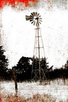 Black and White with red photo of old Windmill in field