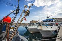 Fishing boats at the harbor in Monopoli Puglia Italy