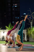 Asian weman group do yoga in city at night