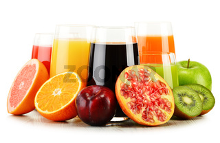 Composition with glasses of assorted fruit juices isolated on white. Detox diet