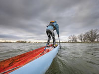 male paddler on a racing stand up paddleboard