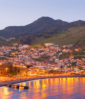 Madeira coast town twilight ocean