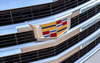 Closeup view of Cadillac logo on the car