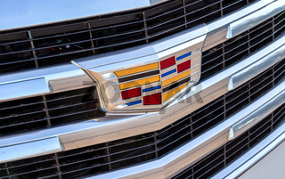 Closeup view of Cadillac logo on the car