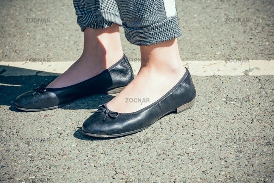 trendy woman wearing stylish black leather shoes