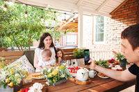 Happy family at table on terrace