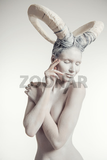 Female with goat body-art. Dedicated to Chinese Horoscope 2015 - Year of the Goat (Sheep)