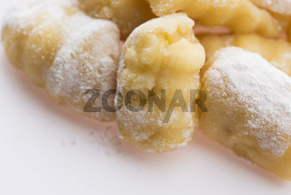 A pile of gnocchi on a white background