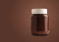 Chocolate spread or nougat cream with hazelnuts in glass jar