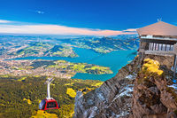 Mount Pilatus aerial cabelway above and town of Luzern aerial view