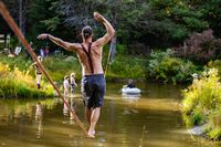 Slack wire artist performs in nature
