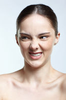 Headshot of emotional female face portrait with rage facial expression.