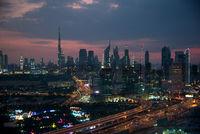 Dubai at sunset. View from Dubai Golden Frame. Burj Khalifa and beautiful modern skyscrapers.