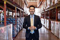 Asian businessman owner portrait in distribution warehouse