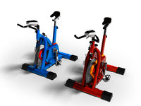 Modern red and blue exercise bikes perspective 3d render on white background with shadow