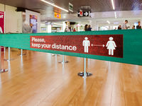 Warning of social distancing in airport