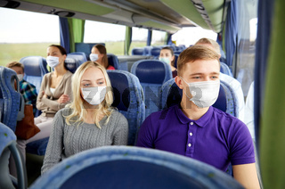 couple in medical masks in travel bus