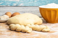 Unbaked braided bun dough. Raw dough.