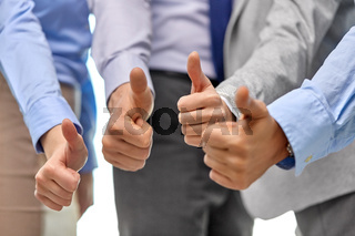 Close up of business team hands showing thumbs up