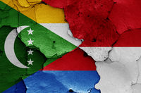 flags of Comoros and Indonesia painted on cracked wall
