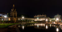 panorama shot of the courtyard insdide the historic Zwinger building in Dresden at night
