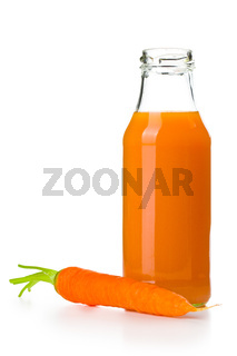 bottle of carrot juice with carrot