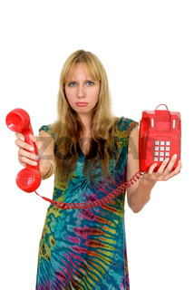 Portrait of beautiful blonde woman giving old telephone