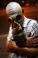 Man in a gas mask on night street