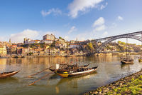 Porto Portugal city skyline at Porto Ribeira and Douro River with Rabelo wine boat
