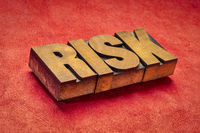 risk word abstract in wood type
