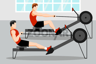 Training athletes on a rowing machine in the gym