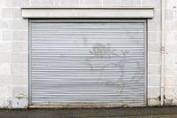 Metal roller security shutter