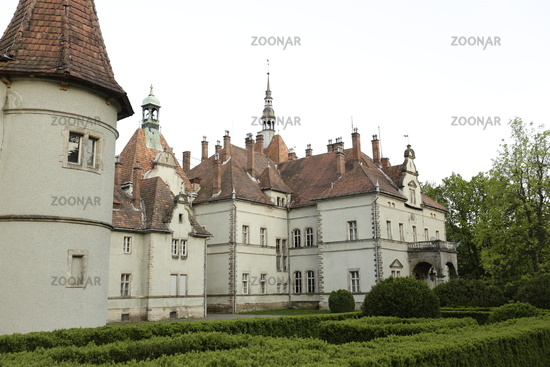 Small castle with green grass in the front