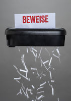 A shredder destroying a document - Evidence - Beweise German
