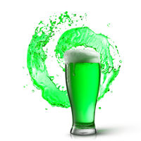 Glass of fresh green beer with splash on a white.