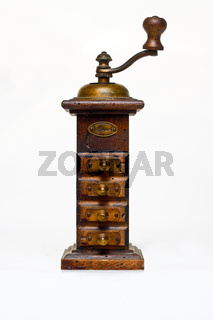 Old wooden pepper mill on white