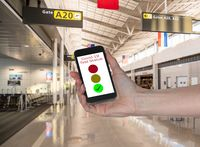 Concept of Covid-19 test status on smartphone App to show immunity to virus at airport